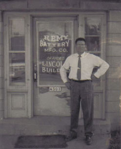 Mike Zurich standing at the front door of Remy Battery on Lincoln Ave